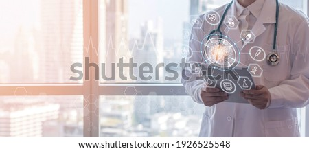 Medical tech science, innovative iot global healthcare ai technology with doctor on telehealth, telemedicine service analyzing online patient health record information data in hospital lab background Royalty-Free Stock Photo #1926525548