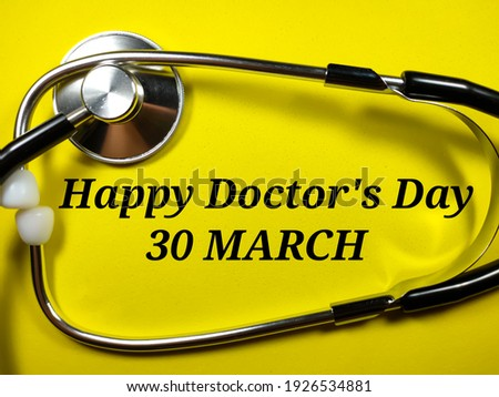Medical concept.Text Happy doctor's day 30 march with stethoscope on yellow background.