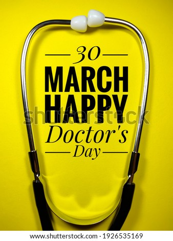 Medical concept.Text 30 MARCH HAPPY DOCTOR'S DAY with stethoscope on yellow background.