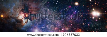 abstract background with night sky and stars. Panorama view universe space shot of milky way galaxy with stars on a night sky background. Elements of this Image Furnished by NASA Royalty-Free Stock Photo #1926587033