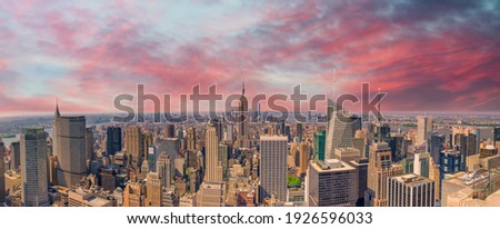 Midtown Manhattan at sunset, New York City. Panoramic aerial view of city skyscrapers at dusk. Royalty-Free Stock Photo #1926596033