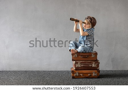 Happy child playing outdoor. Smiling kid dreaming about summer vacation and travel. Imagination and freedom concept Royalty-Free Stock Photo #1926607553