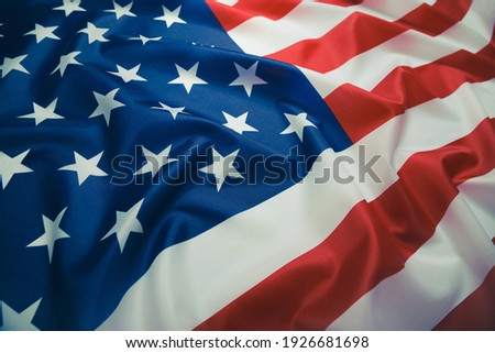 Close up of ruffled American flag. Satin texture curved flag of USA. Memorial Day or 4th of July. Banner, freedom concept Royalty-Free Stock Photo #1926681698