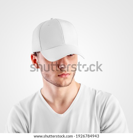 Template of a white baseball cap on a guy's head, headdress for protection from the sun, isolated on background. Sports hat mockup with visor, universal panama hat, for design presentation, front view Royalty-Free Stock Photo #1926784943