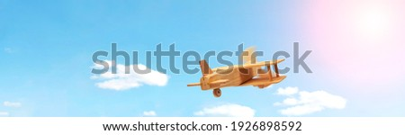 Craft wooden plane and blue sky. Dream concept Royalty-Free Stock Photo #1926898592