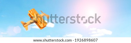 Craft wooden plane and blue sky. Dream concept Royalty-Free Stock Photo #1926898607