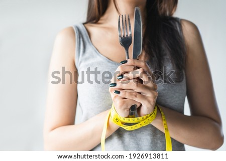 diet for good health concept. Woman tied her hand and restraint do not to so much food. Royalty-Free Stock Photo #1926913811