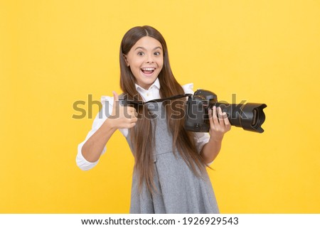 happy teen girl photographer use digital photo camera show thumb up, photographing.