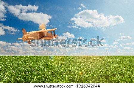 Craft wooden plane and blue sky. Dream concept Royalty-Free Stock Photo #1926942044