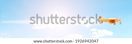 Craft wooden plane and blue sky. Dream concept Royalty-Free Stock Photo #1926942047