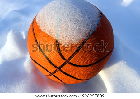 basketball ball in the snow