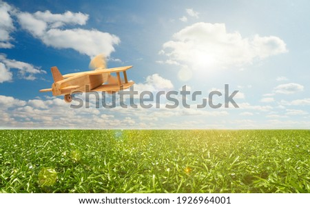 Craft wooden plane and blue sky. Dream concept Royalty-Free Stock Photo #1926964001