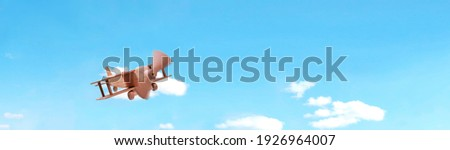 Craft wooden plane and blue sky. Dream concept Royalty-Free Stock Photo #1926964007