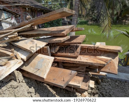 Stacks of wood pics with nails for construction work