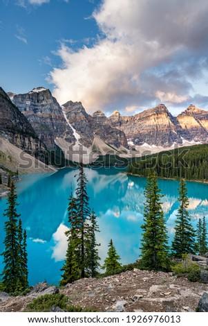 Moraine lake at sunrise, Banff. Canadian Rockies, Alberta, Canada Royalty-Free Stock Photo #1926976013