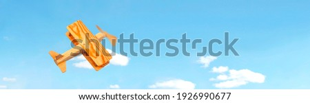 Craft wooden plane and blue sky. Dream concept Royalty-Free Stock Photo #1926990677