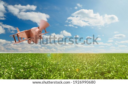 Craft wooden plane and blue sky. Dream concept Royalty-Free Stock Photo #1926990680