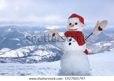 Funny snowman outdoors on sunny day, space for text Royalty-Free Stock Photo #1927001747