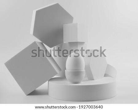 White egg on white platforms, minimalism food concept, monochrome.