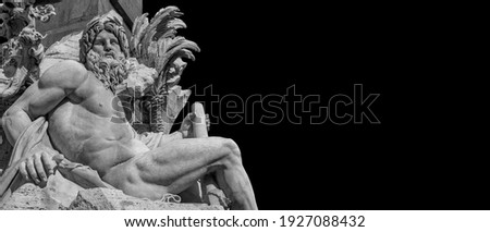 Greek or Roman God. Marble statue of River Ganges statue from baroque Fountain of Four River, erected in the 17th century in the historic center of Rome (Black and White with copy space) Royalty-Free Stock Photo #1927088432