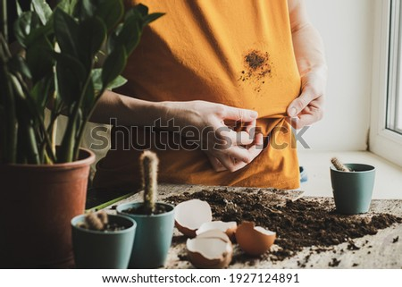 Girl hand showing dirty stain on cloth for cleaning and washing. dirt stains in daily life concept. High quality photo Royalty-Free Stock Photo #1927124891
