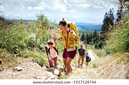 Family with small children hiking outdoors in summer nature, walking in High Tatras. Royalty-Free Stock Photo #1927128746