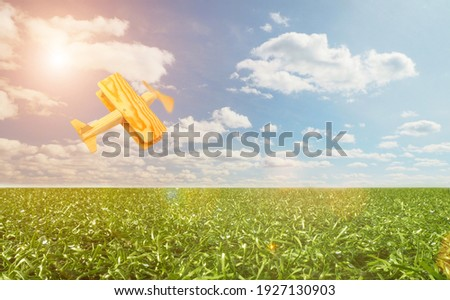 Craft wooden plane and blue sky. Dream concept Royalty-Free Stock Photo #1927130903