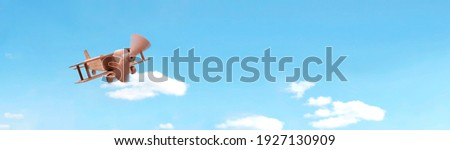 Craft wooden plane and blue sky. Dream concept Royalty-Free Stock Photo #1927130909
