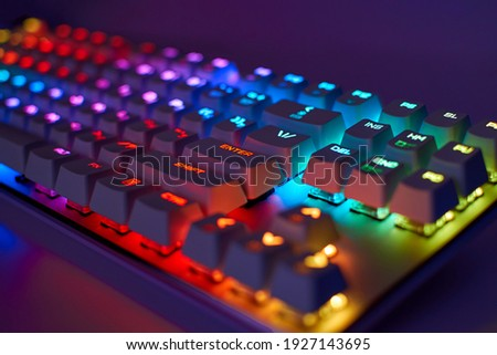 RGB gaming keyboard. Bright colorful keyboard, soft focus. Mechanical keyboard with RGB light, blurred background. Royalty-Free Stock Photo #1927143695