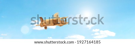 Craft wooden plane and blue sky. Dream concept Royalty-Free Stock Photo #1927164185