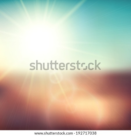 Blurry evening scene with brown field, sun burst, blue and green blur sky,  illustration