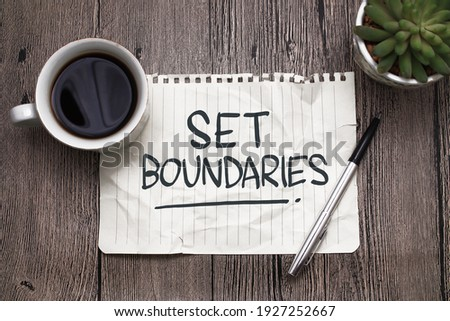 Set boundaries, text words typography written on paper against wooden background, life and business motivational inspirational concept Royalty-Free Stock Photo #1927252667