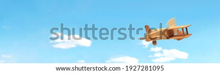 Craft wooden plane and blue sky. Dream concept Royalty-Free Stock Photo #1927281095