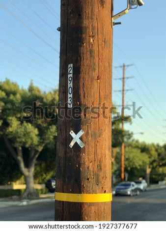Wooden electric pillar with signpost