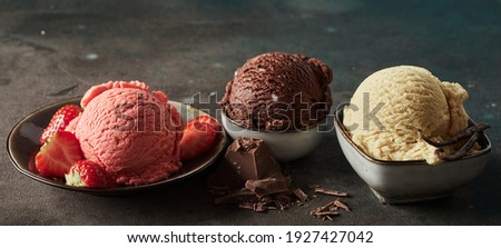 Wide angle of collection of delicious gelati with fresh strawberries and grated chocolate with aromatic vanilla pod Royalty-Free Stock Photo #1927427042