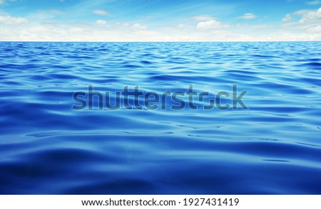 Blue sea water. Ocean surface natural background on sky Royalty-Free Stock Photo #1927431419