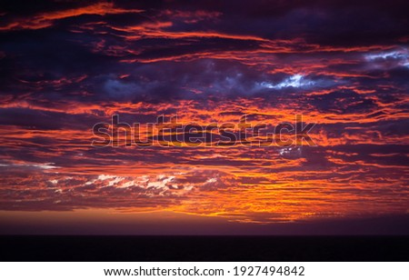 Dramatic cloudy sky sunset view. Dramatic sunset sky. Dramatic sunset sky clouds. Dramatic sunset view Royalty-Free Stock Photo #1927494842