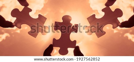 three hands of businessman to connect couple 3 piece with sky background.Jigsaw alone wooden puzzle against sun rays.one part of whole. symbol of association and connection.business strategy. Royalty-Free Stock Photo #1927562852