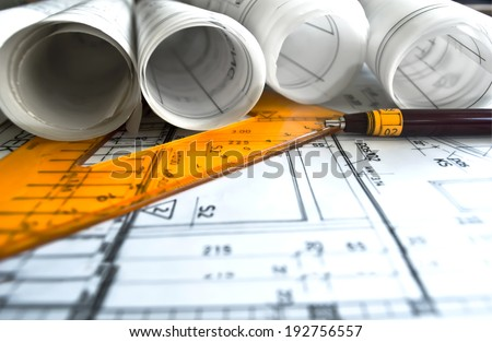 Architecture rolls architectural plans project architect blueprints Royalty-Free Stock Photo #192756557