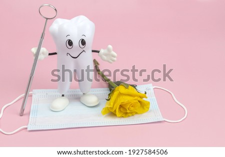 cartoon model of a tooth with a dental mirror, a rose and a protective face mask on a pink background