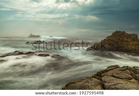 Long exposure water, beautiful seascape, ocean views, rocky coastline, sunlight, on the horizon. Composition of nature. Sunset scenery background. Cloudy sky. California coast. Royalty-Free Stock Photo #1927595498