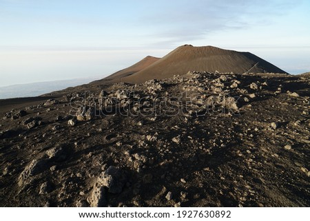 Etna summit and crater trek hiking guided tour concept, Mount Etna southern summit crater with active volcanic activity before eruption and panoramic view, Sicily, Italy