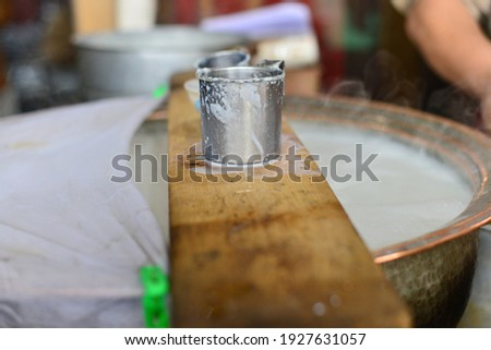 in this picture you can see a glass and milk , its a shop in peshawar pakistan , from here you can buy milk for drinking and other purposes