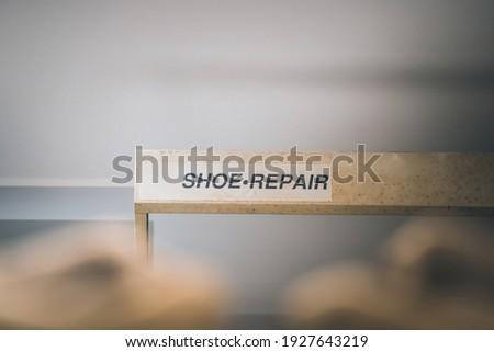Shoe repair banner, shoe maker badge
