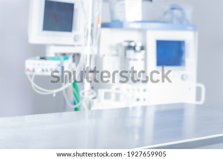 Image of a medical office. Focus on the operating table. The background is an anastasia apparatus. Medical concept. Mixed media Royalty-Free Stock Photo #1927659905