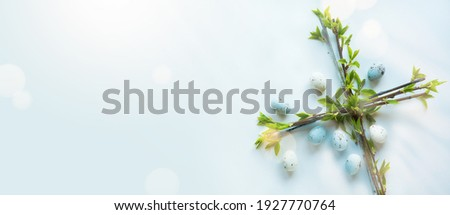 Art Happy Easter Holiday banner or greeting card background with Easter flower cross and Easter eggs on blue background; Christian awakening life symbol