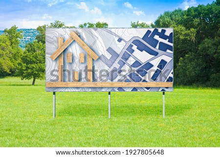 Blank advertising billboard in a green field with wooden building - The advantages of wood as a building material in the construction industry - concept image.