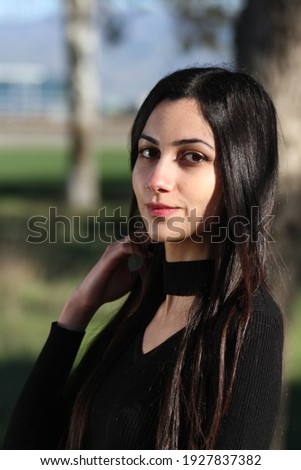 Middle Eastern girl in a park Royalty-Free Stock Photo #1927837382