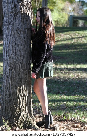 Middle Eastern girl in a park Royalty-Free Stock Photo #1927837427