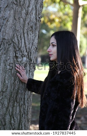 Middle Eastern girl in a park Royalty-Free Stock Photo #1927837445